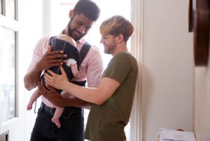 Love is Family, gay male couple with newborn baby through surrogacy